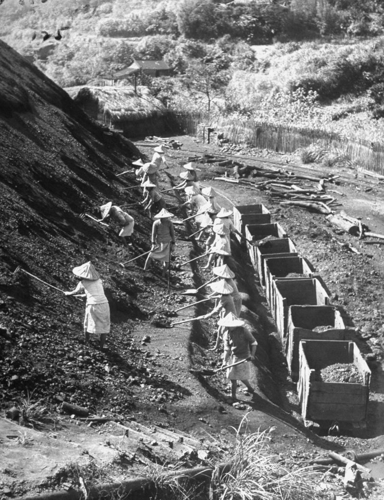 Women transferring coal from a hillside to mine cars in Taipeh, China. (Photo by Jack Birns/The LIFE Picture Collection © Meredith Corporation)