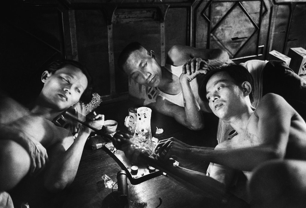 """Opium addicts smoking, sleeping, and talking together in a """"desintoxication clinic."""" (Photo by Jack Birns/The LIFE Picture Collection © Meredith Corporation)"""