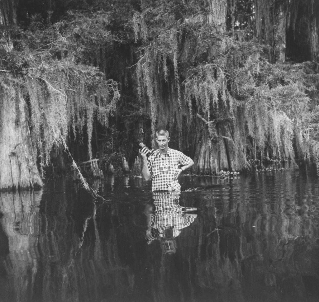 Stan Wayman standing in a swamp with his camera. (Photo by Stan Wayman/The LIFE Picture Collection © Meredith Corporation)