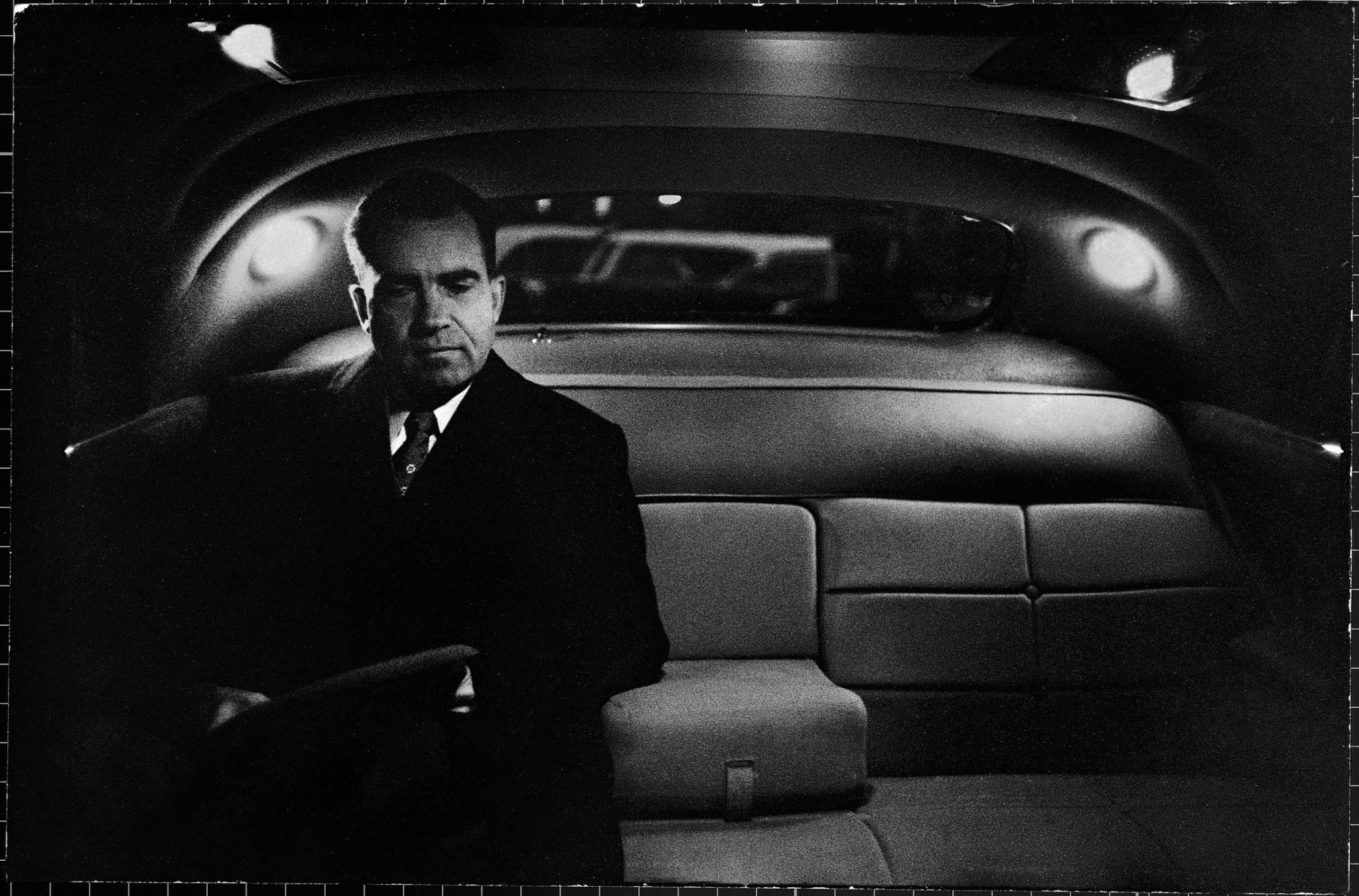 Vice President Richard Nixon sitting in the back seat of a dimly lit limousine after a day taking over duties for President Eisenhower, during his hospitalization from a stroke. (Photo by Hank Walker/The LIFE Picture Collection © Meredith Corporation)