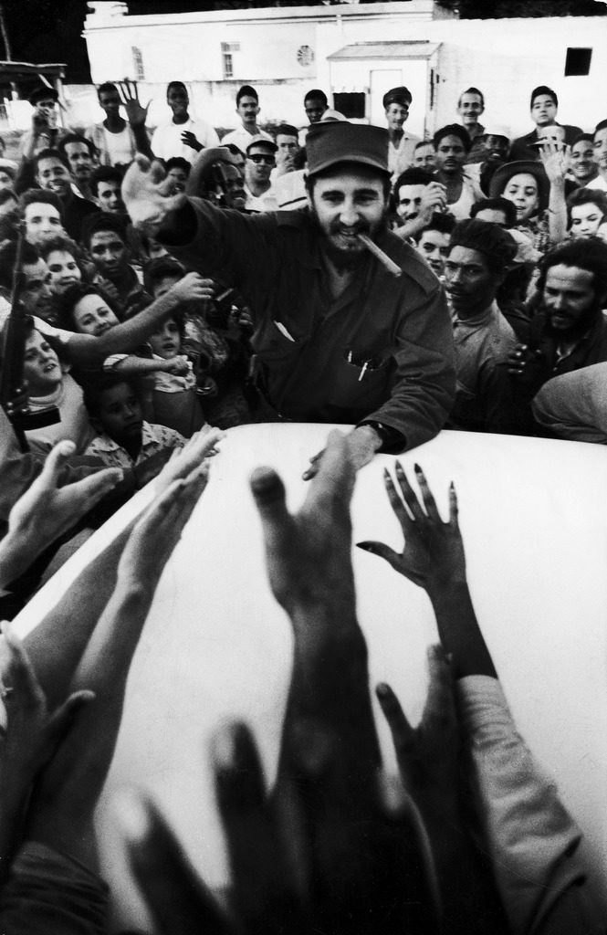 Rebel leader Fidel Castro being cheered by a village crowd on his victorious march to Havana. (Photo by Grey Villet/The LIFE Picture Collection © Meredith Corporation)