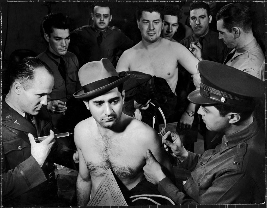 Draftee getting smallpox and typhoid inoculations in the first peacetime draft, Fort Dix, N.J., 1940. (Photo by George Strock/The LIFE Picture Collection © Meredith Corporation)