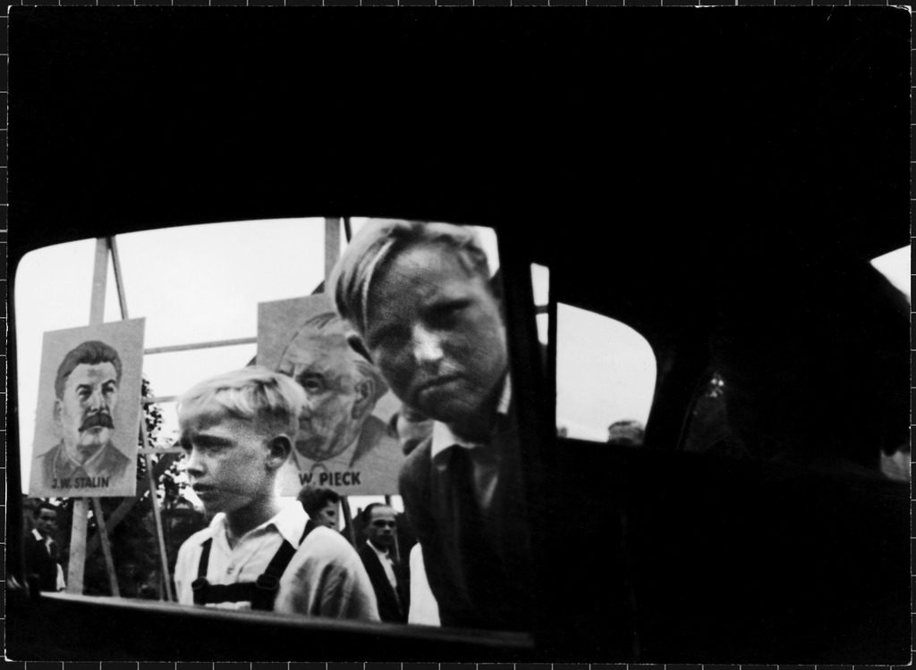 "At the Leipzig Industrial Fair in East Germany, envious kids peer into a car and shout ""From America! Look!"" (Photo by Charles Steinheimer/The LIFE Picture Collection © Meredith Corporation)"