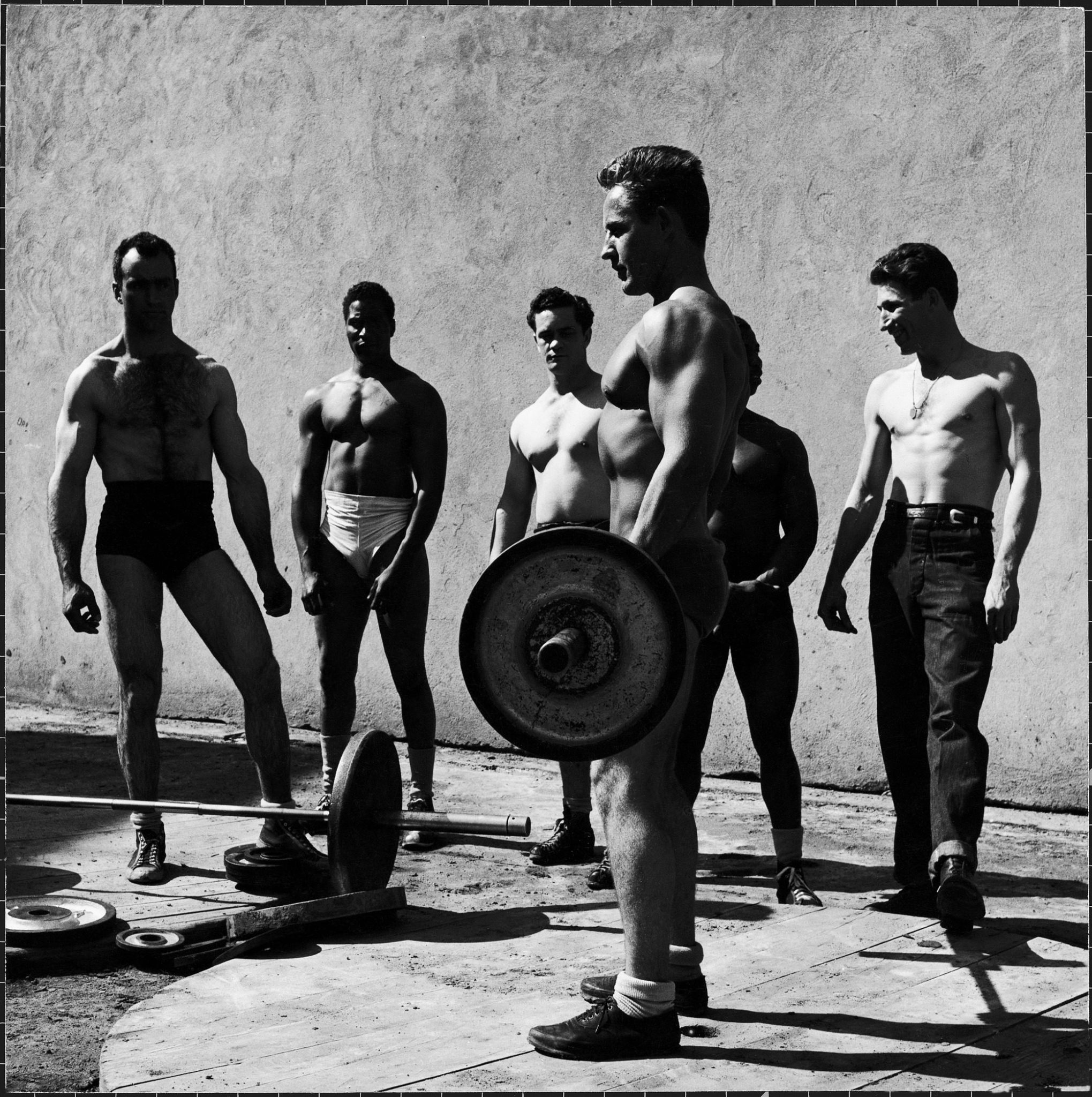 Prisoners at San Quentin weightlifting in prison yard during recreation period. (Photo by Charles Steinheimer/The LIFE Picture Collection © Meredith Corporation)