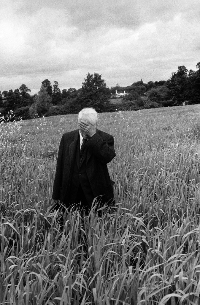 Poet Robert Frost standing in Oxford field with his hand over his face. (Photo by Howard Sochurek/The LIFE Picture Collection © Meredith Corporation)