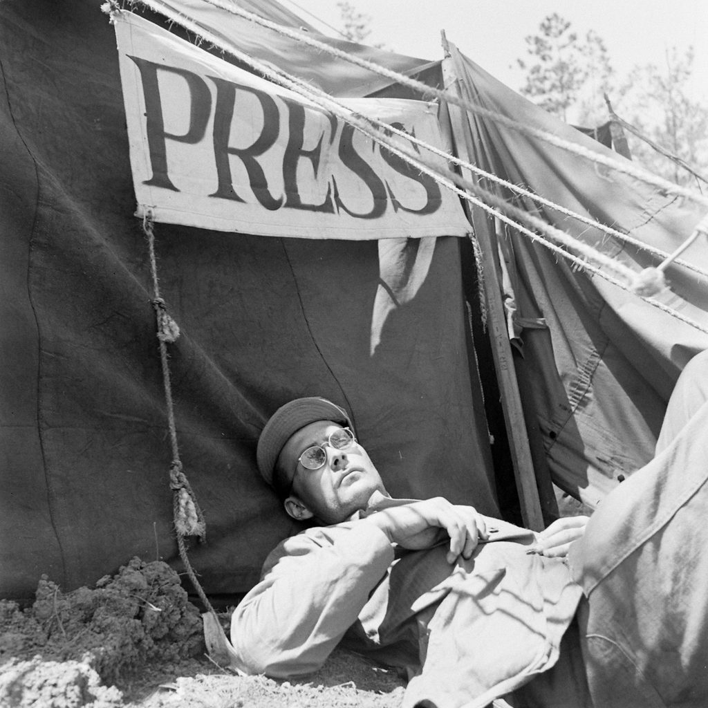 W. Eugene Smith in Okinawa, Japan, during World War II in front of the press tent. (Photo by W. Eugene Smith/The LIFE Picture Collection © Meredith Corporation)