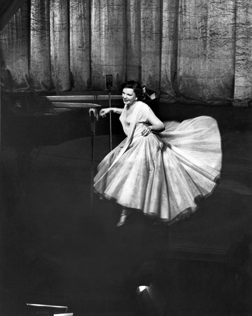 Actress/singer Judy Garland twirling into a dance step during a performance at the Paladium. (Photo by Cornell Capa/The LIFE Picture Collection © Meredith Corporation)