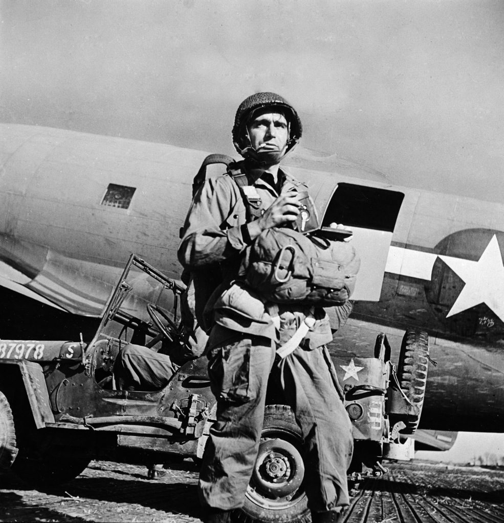 Robert Capa wearing parachute and gear prior to jumping in with troops during WWII. (Photo by Robert Capa/The LIFE Picture Collection © Meredith Corporation)