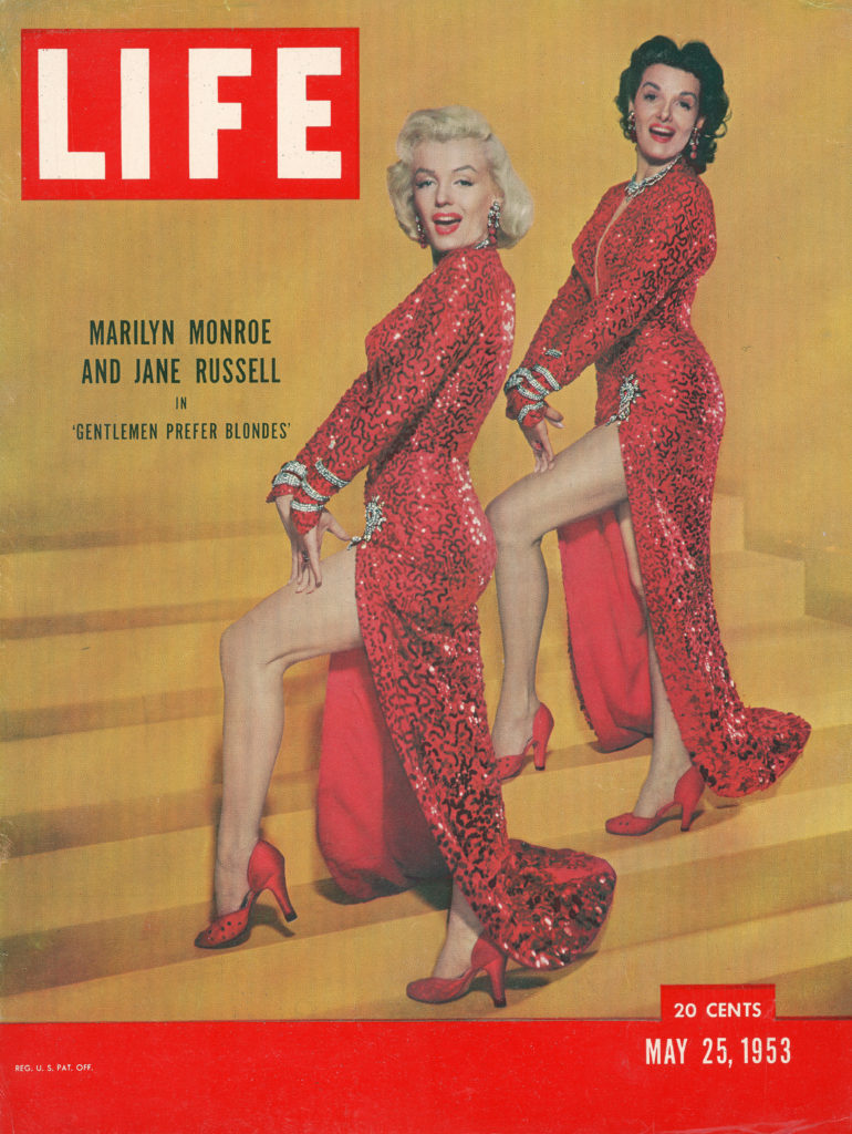 """LIFE magazine cover published May 25, 1953. Featuring actresses Marilyn Monroe & Jane Russell in scene from the film """"Gentlemen Prefer Blondes."""" (Photo by Edward Clark/The LIFE Picture Collection © Meredith Corporation)"""