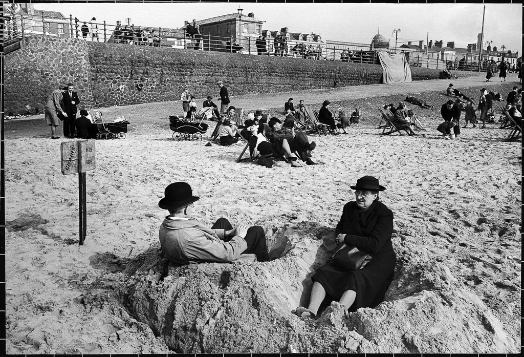 People sitting in the sand at Blackpool beach. (Photo by Ian Smith/The LIFE Picture Collection © Meredith Corporation)