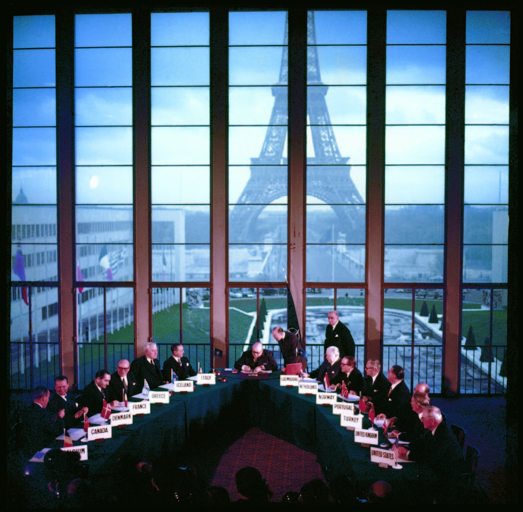Representatives of 14 NATO nations (including US Secretary of State John Foster Dulles (fore, far R) signing a pact admitting Germany as 15th member in a ceremony at Palais de Chaillot. (Photo by Frank Scherschel/The LIFE Picture Collection © Meredith Corporation)
