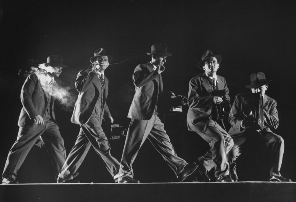Multiple exposure photograph of LIFE photographer Frank Scherschel smoking & handling a camera, running & crouching as he would do on assignment. (Photo by Gjon Mili/The LIFE Picture Collection © Meredith Corporation)
