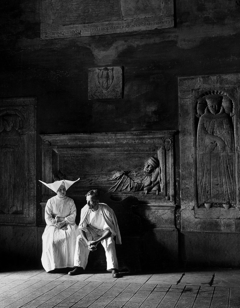 Two people sitting in hospital where St. Catherine nursed people with the plague. (Photo by Walter Sanders/The LIFE Picture Collection © Meredith Corporation)