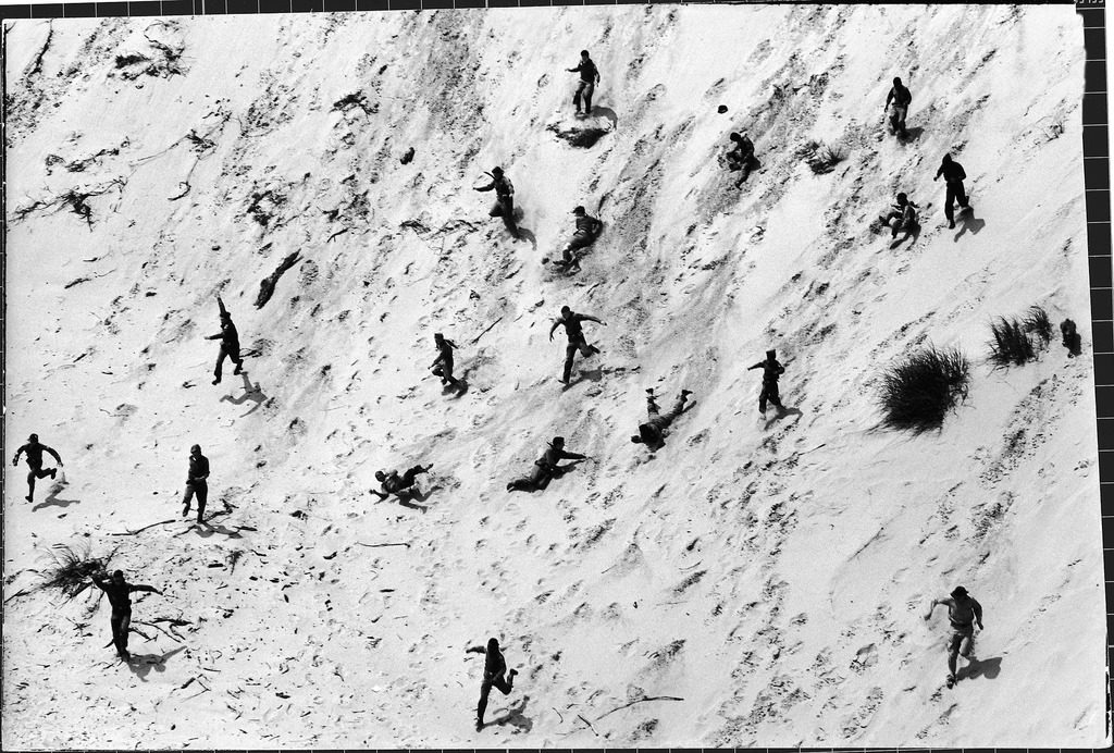 Boy Scouts racing down a dune at the Indiana Dunes. (Photo by Michael Rougier/The LIFE Picture Collection © Meredith Corporation)