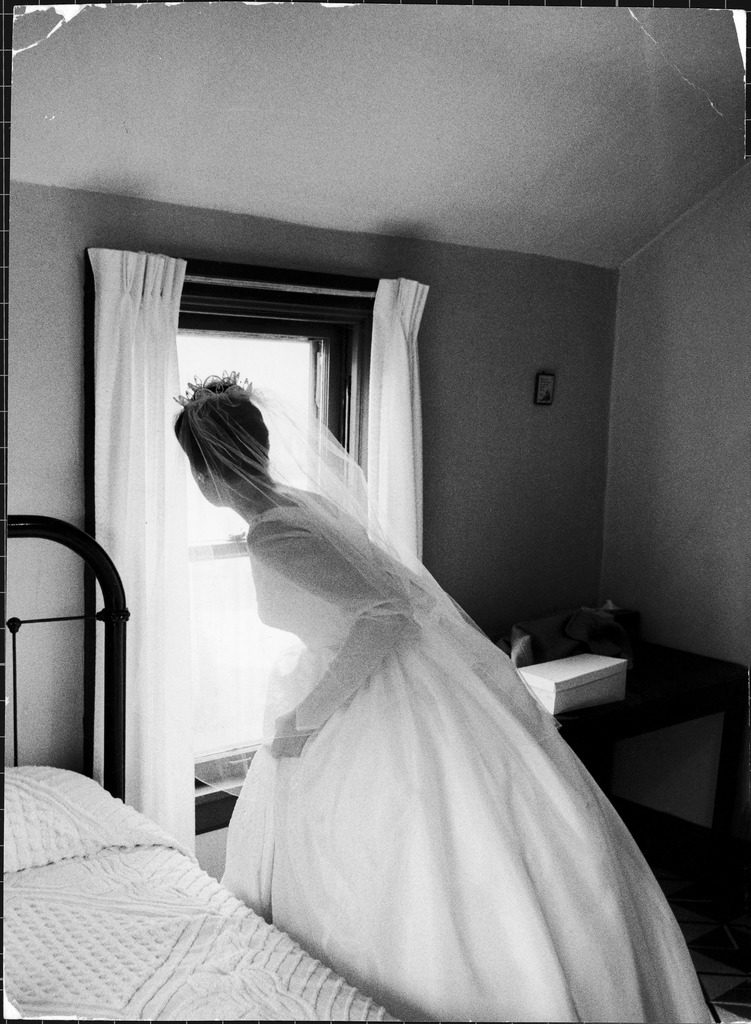 Bride prepares for wedding, in traditional white gown, 19th century wedding dress. (Photo by Michael Rougier/The LIFE Picture Collection © Meredith Corporation)
