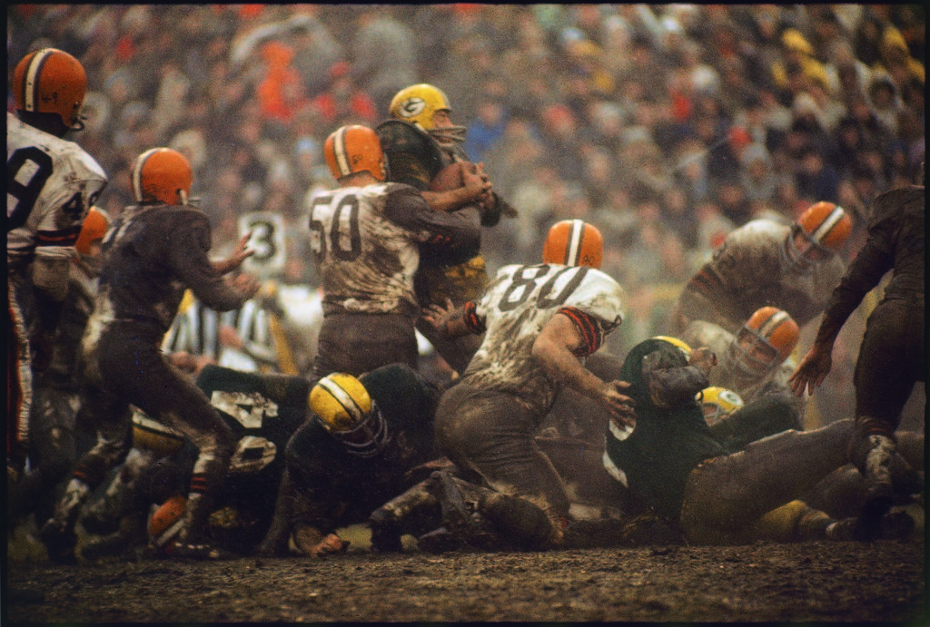 Cleveland Browns Vince Costello (#50) wrapping a tackle around Green Bay Packers running back Jim Taylor. (Photo by Arthur Rickerby/The LIFE Picture Collection © Meredith Corporation)