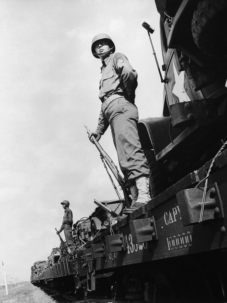 US soldiers standing guard on a troop train. (Photo by Myron Davis/The LIFE Picture Collection © Meredith Corporation)