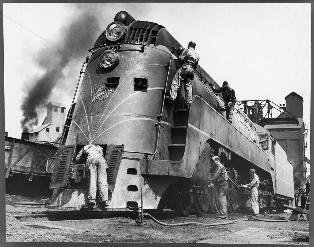 Soldiers working on a locomotive. (Photo by Myron Davis/The LIFE Picture Collection © Meredith Corporation)