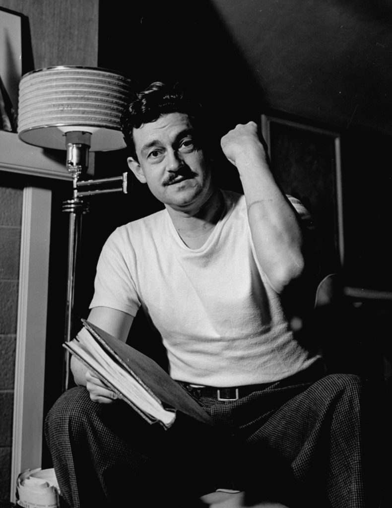 Writer and director Preston Sturges, in white tee shirt, showing cut on arm. (Photo by Paul Dorsey/The LIFE Picture Collection © Meredith Corporation)