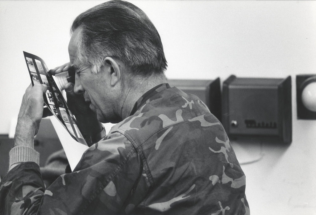 David Douglas Duncan reviewing a contact sheet from one of his assignments from the Korean War. (Photo by Gjon Milil /The LIFE Picture Collection © Meredith Corporation)