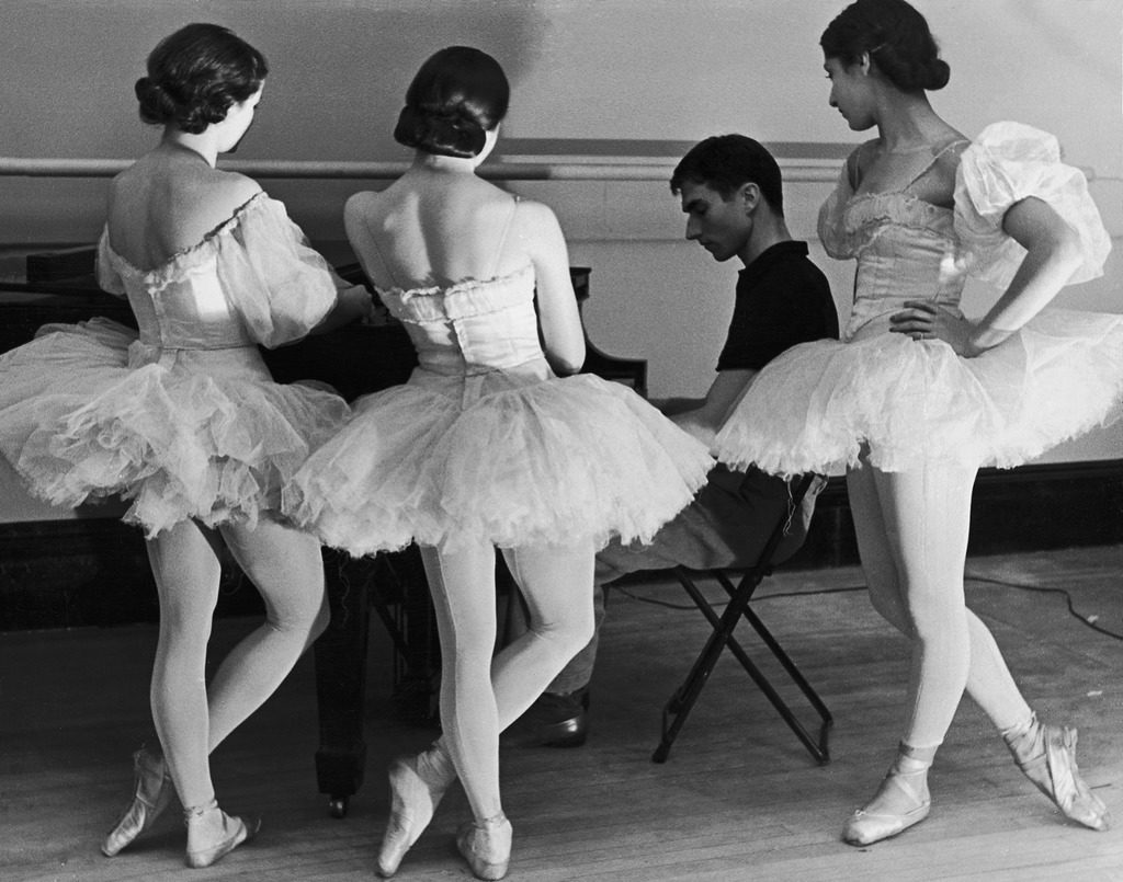 Ballerinas at George Balanchine's American School of Ballet gathered around accompanist during rehearsal. (Photo by Alfred Eisenstaedt/The LIFE Picture Collection © Meredith Corporation)