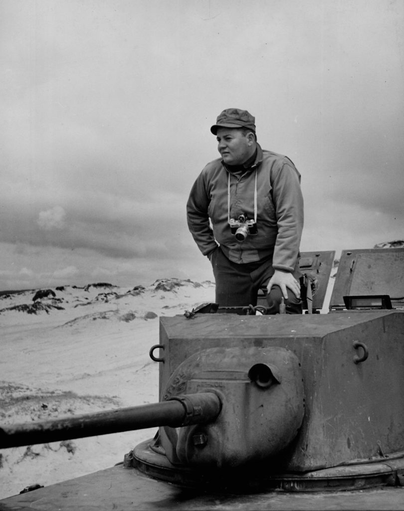 Photographer John Florea standing in open hatch of a tank. (Photo by John Florea/The LIFE Picture Collection © Meredith Corporation)