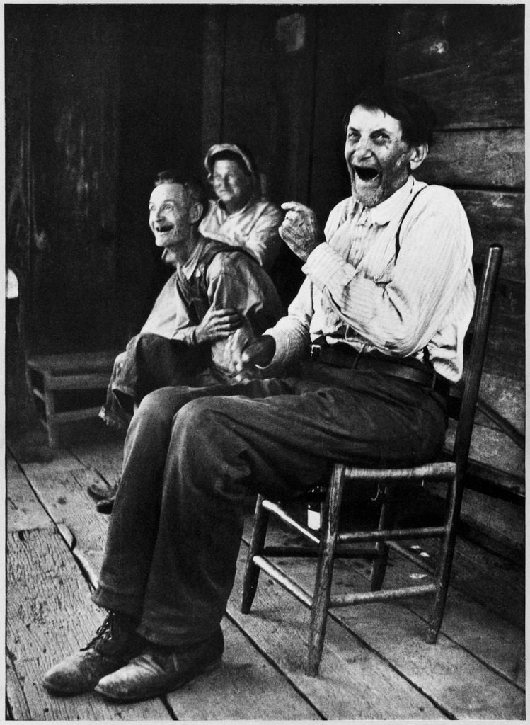 Former Confederate soldier John Salling sitting in a chair on a porch with some friends. (Photo by Alan Grant/The LIFE Picture Collection © Meredith Corporation)