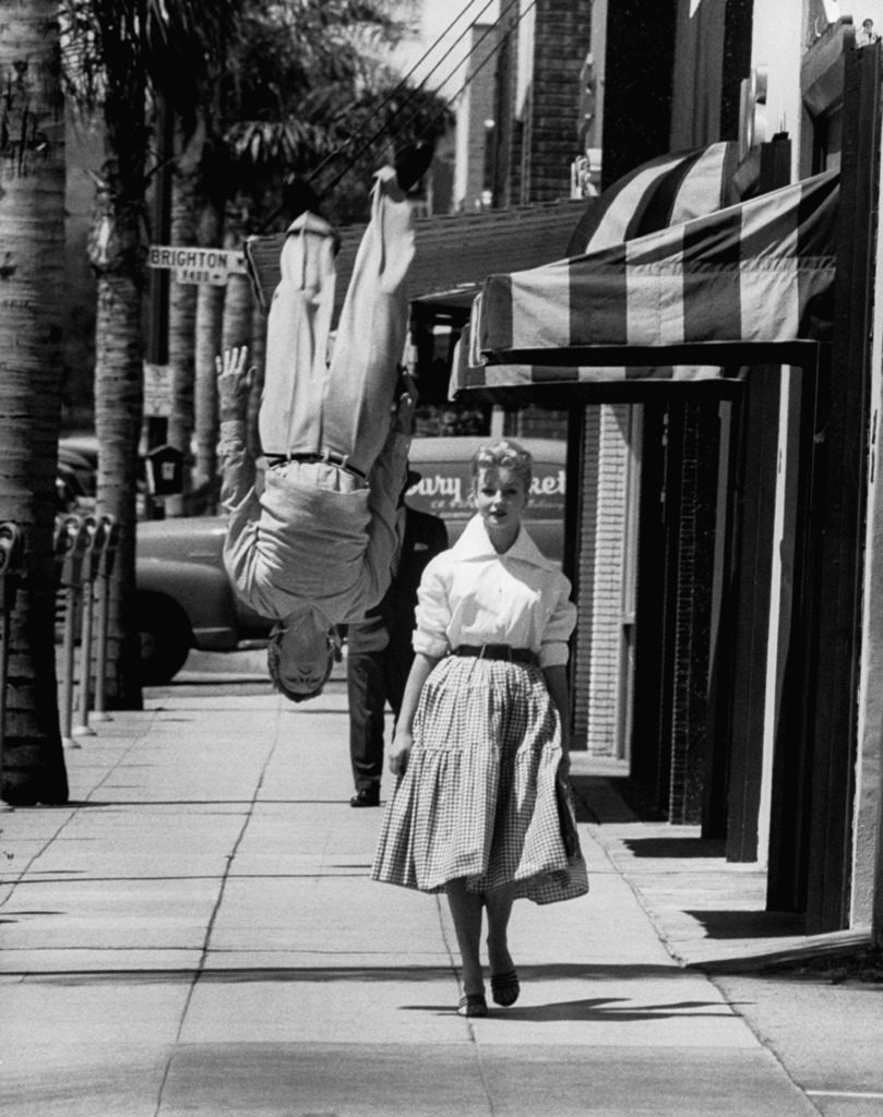 Acrobat and actor, Russ Tamblyn doing a flip on the sidewalk with starlet Venetia Stevenson. (Photo by Allan Grant/The LIFE Picture Collection © Meredith Corporation)