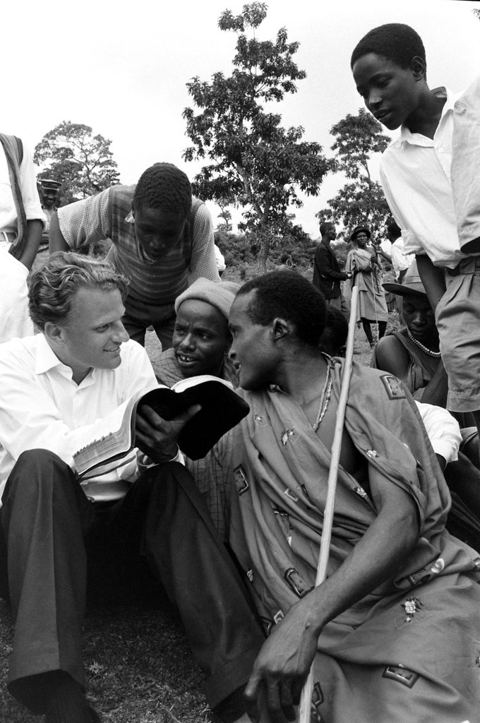 During his 1960 African crusade, Graham explained the Bible to a group of Waarusha warriors living in a village at the base of Mount Meru, not far from Kilimanjaro, in Tanganyika (now Tanzania).