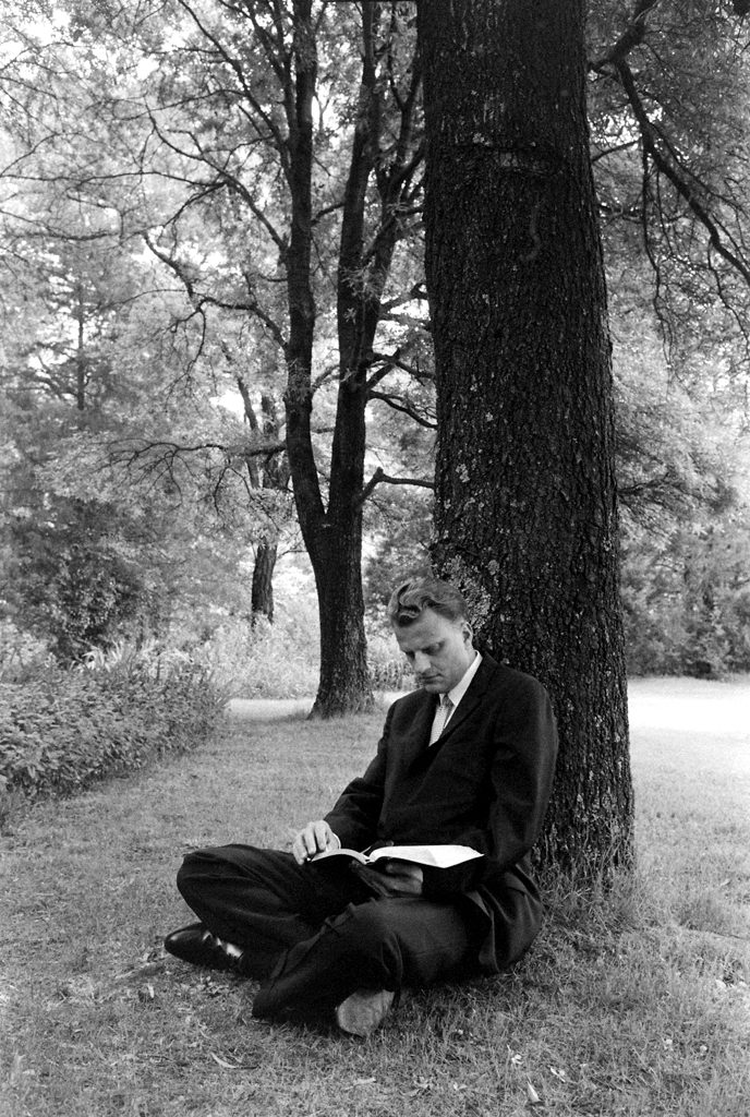 """Billy Graham reads from the book of Isaiah, Chapter 33, Verse 2: """"O Lord, be gracious unto us; we have waited for thee: be thou their arm every morning, our salvation also in the time of trouble."""""""
