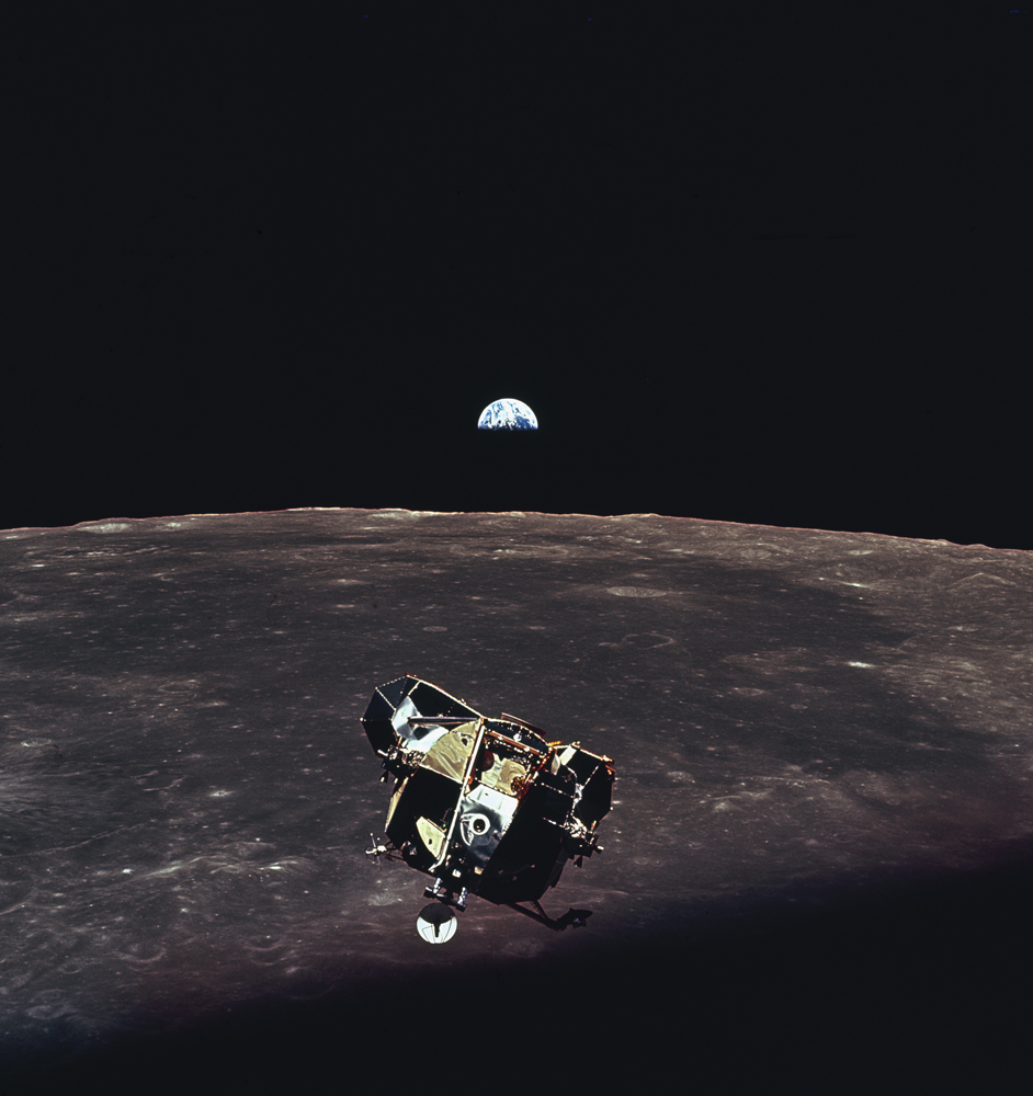 With the Earth visible in the distance above the moon's bleak horizon, Apollo 11's lunar module ascends toward the command module (piloted by astronaut Michael Collins while Armstrong and Aldrin were on the lunar surface).