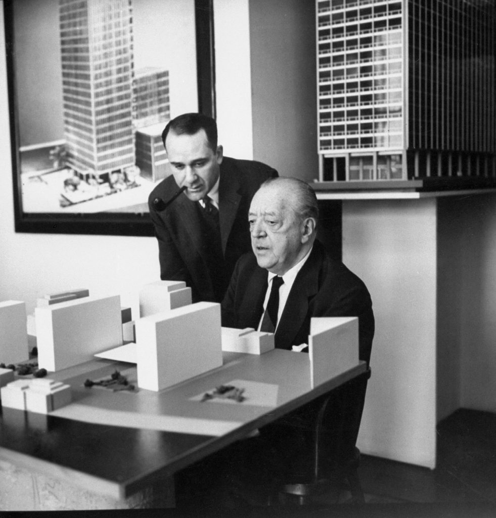 00957887.JPGPlanning new project to remake Battery park, Mies discusses model with Herbert Greenwald, a real estate developer. Greenwald gave Mies his first Chicago apartments commission, now devotes himself to promoting Mies projects