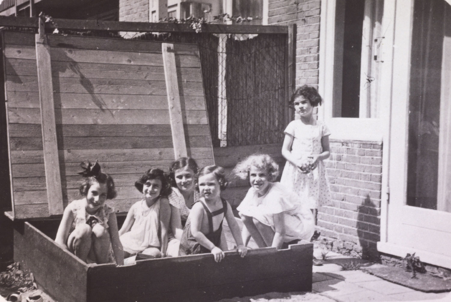 "Left to right: Hanneli Goslar (a.k.a., ""Lies Goosens"" in early editions of the Diary), Anne Frank, Dolly Citroen, Hannah Toby, Barbara Ledermann and Susanne Ledermann (standing), Amsterdam, 1937."