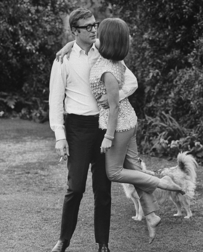 Michael Caine sweeps Natalie Wood off her feet, 1963.