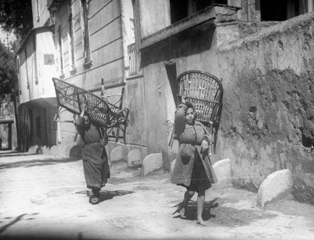 Civilians move furniture during the 1944 eruption of Mt. Vesuvius, Italy.