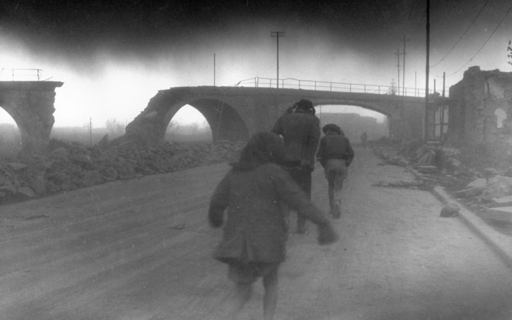 Refugees make their way through dust during the 1944 eruption of Mt. Vesuvius, Italy.