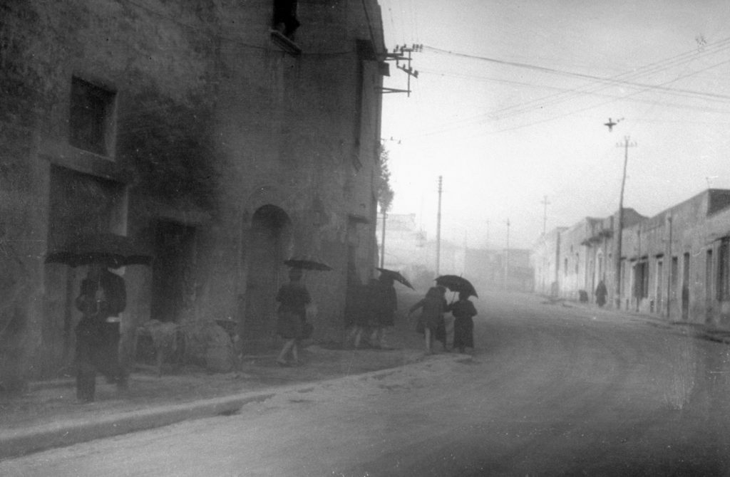 People make their way through ash and dust during the 1944 eruption of Mt. Vesuvius, Italy.