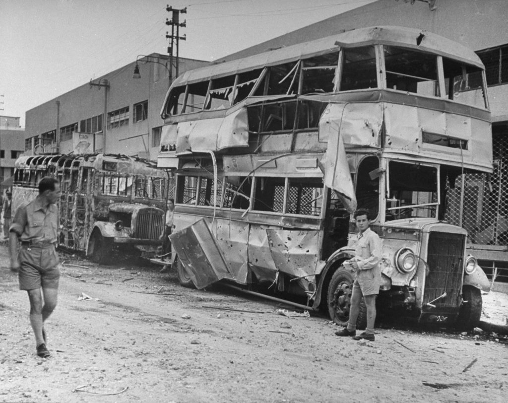 Burned-out buses seen shortly after the establishment of the state of Israel, exact location unknown, May 1948.