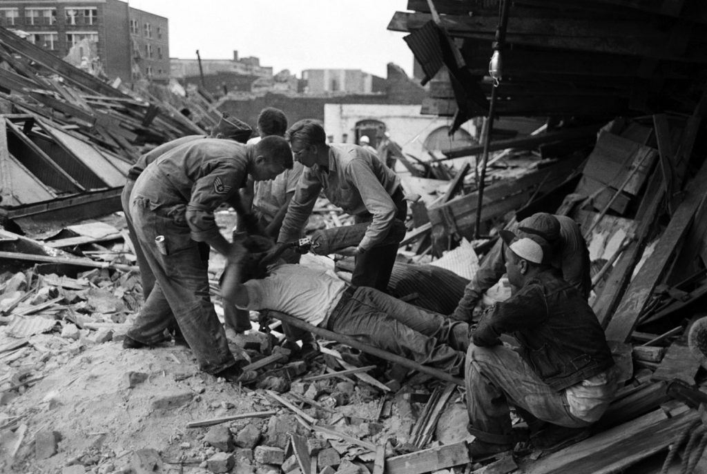 Rescuers administer oxygen to a survivor in Waco, Texas, after an F5 tornado hit the city, May 1953.