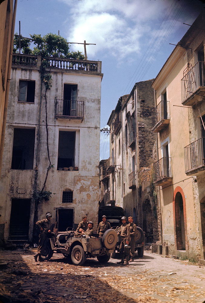 American soldiers rest in a courtyard during the drive towards Rome, World War II.