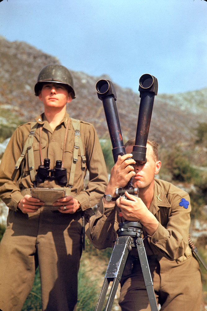 American soldier trying to spot German positions during the Allied drive towards Rome, 1944.