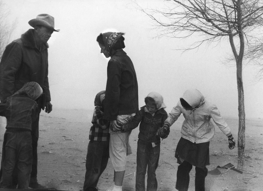 Coloradans Art Blooding and his family inspect their newly bought farm in 50-mph wind.