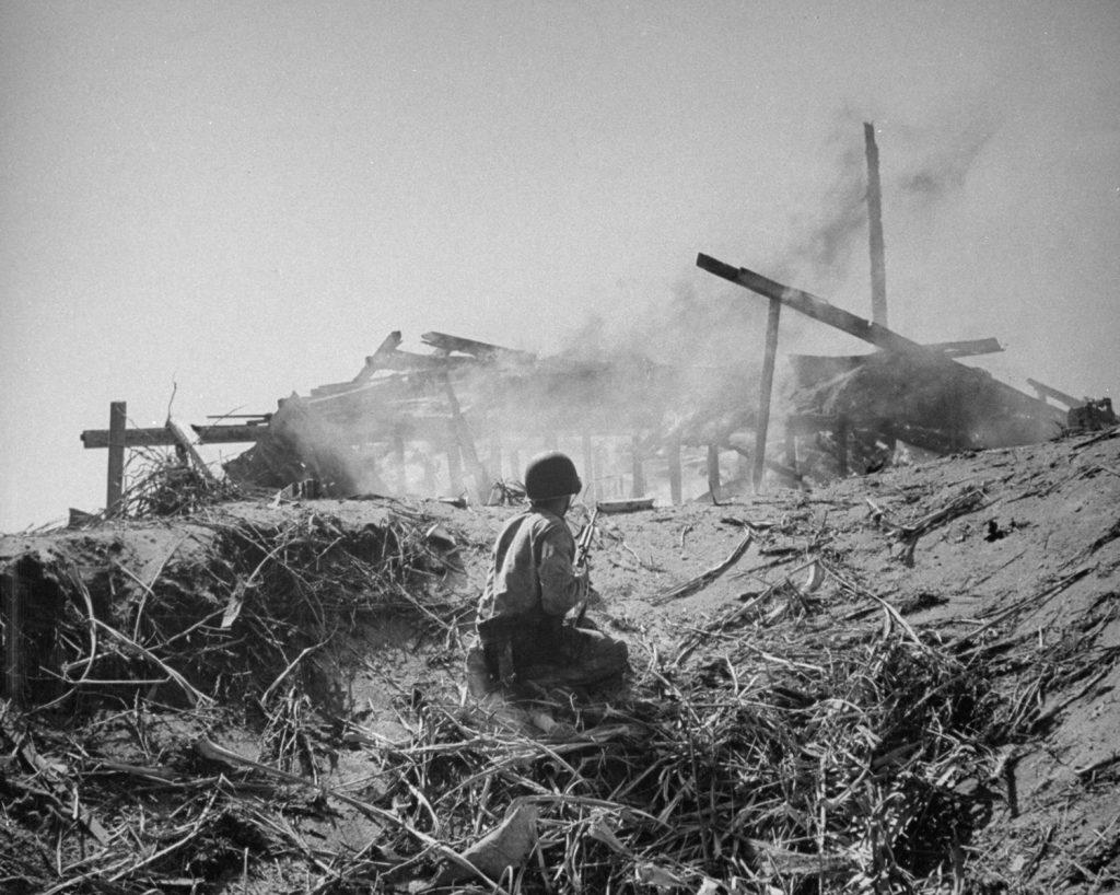 A U.S. Marine on Engebi Island during Battle of Eniwetok, February 1944.