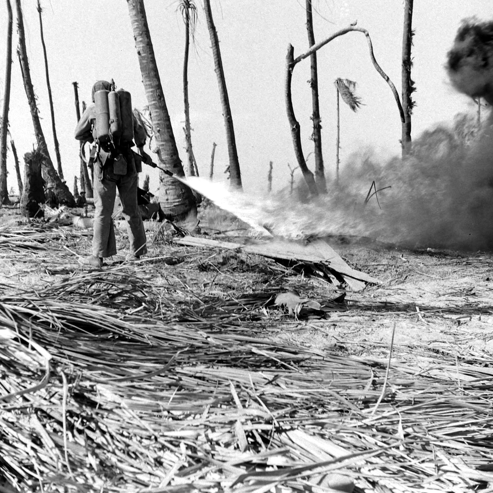 American Marines use a flamethrower on a Japanese pillbox during Battle of Eniwetok, February 1944.