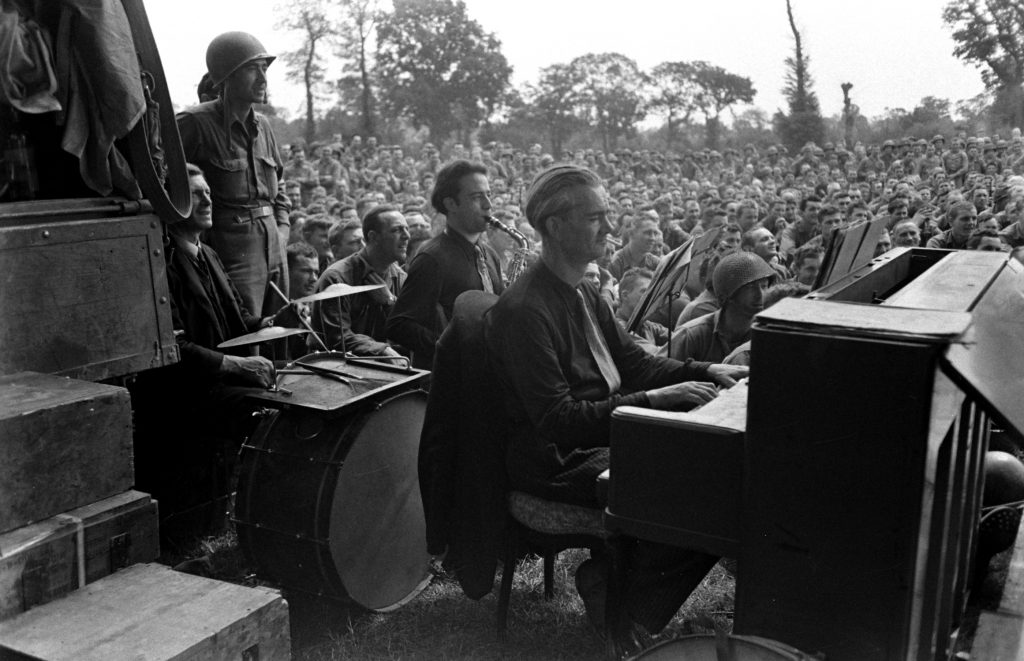 First organized show for American troops after D-Day, Normandy, July 1944.