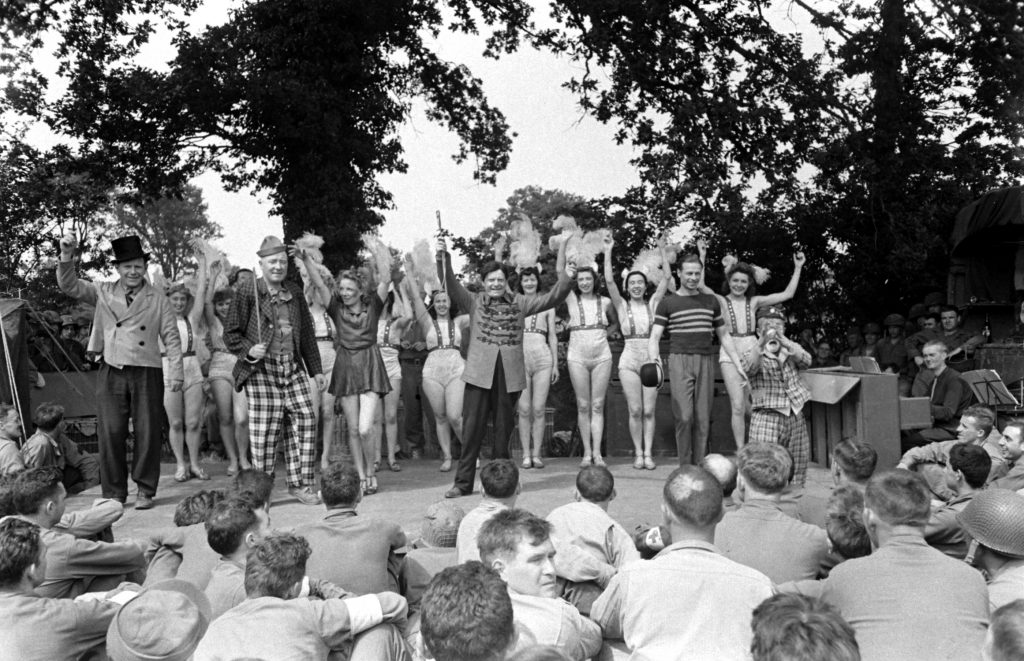 French performers in first organized show for American troops after D-Day take a bow, Normandy, July 1944.
