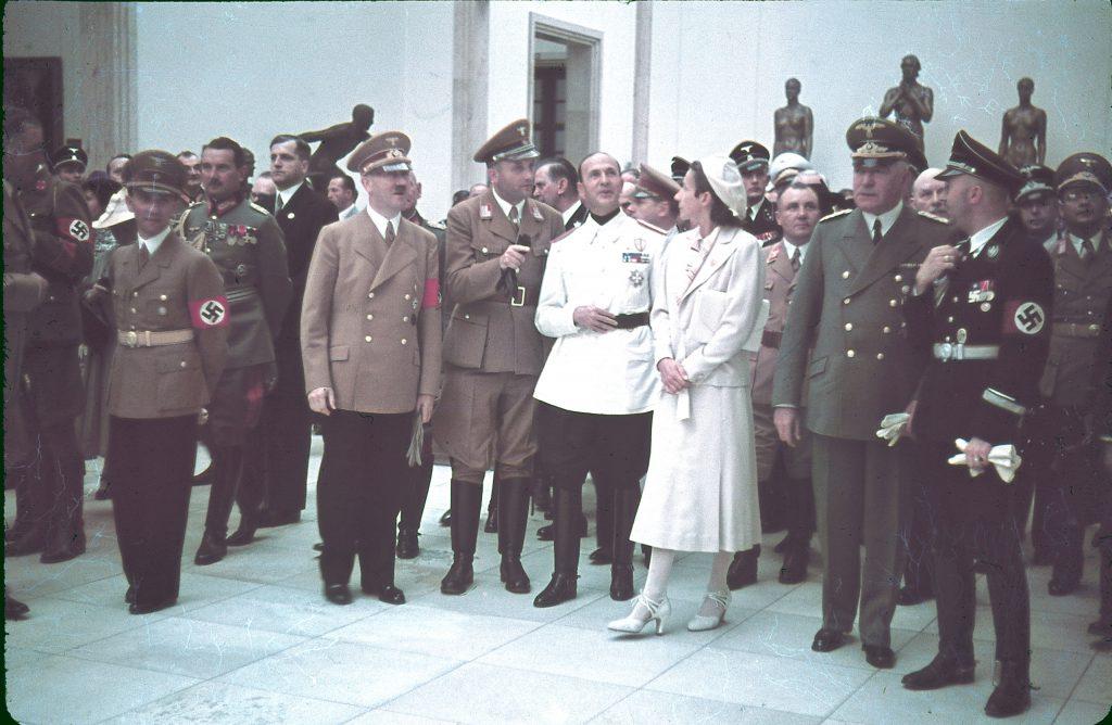 "Joseph Goebbels, Eugen Ritter von Schobert, Adolf Hitler, Italian ambassador Dino Alfieri (in white jacket), architect Gerdy Troost, Martin Bormann (behind Troost), Heinrich Himmler (far right) and others at Munich's Haus der Kunst for the 1939 ""Day of German Art."""