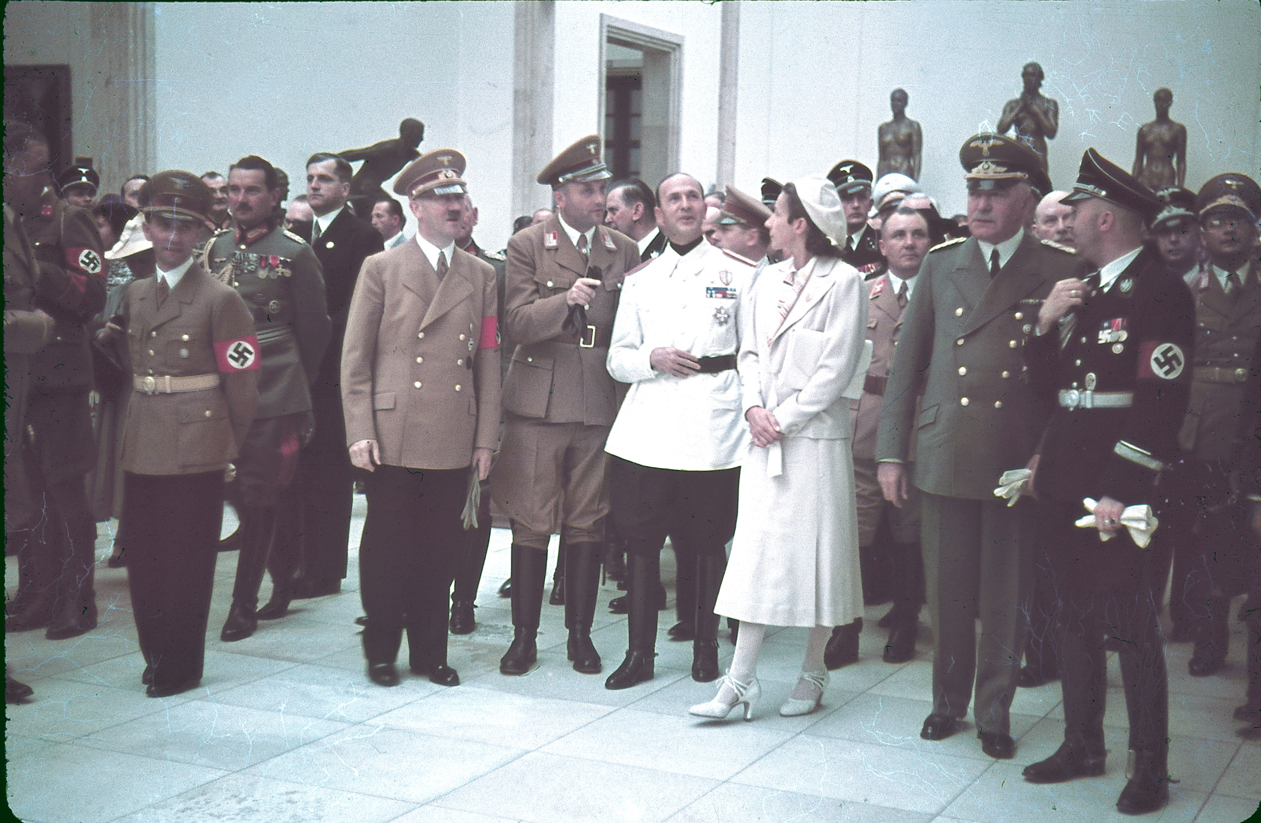 "Joseph Goebbels, Eugen Ritter von Schobert, Adolf Hitler, Italian ambassador Dino Alfieri (in white jacket), architect Gerdy Troost, Martin Bormann (behind Troost), Heinrich Himmler (far right) and others at Munich's Haus der Kunst for the 1939 ""Day of German Art."""