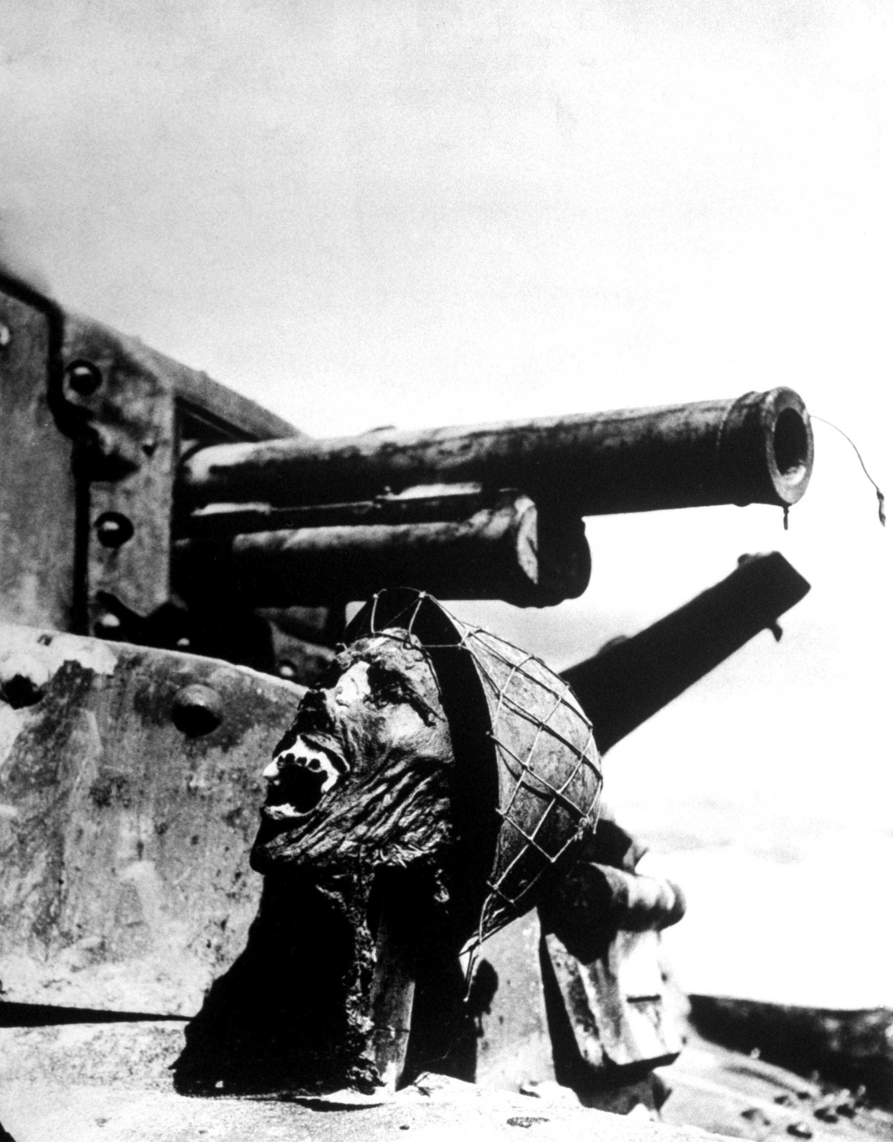 Severed head of a Japanese soldier, propped up on a disabled tank, Guadalcanal, 1942.