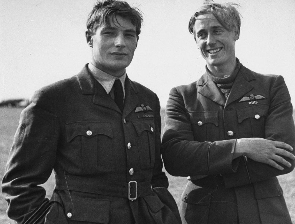 Two pilots (Flying Officer Albert Gerald Lewis on right, unidentified flyer at left) between flights during the Battle of Britain, RAF Fighter Command airfield, 1940.